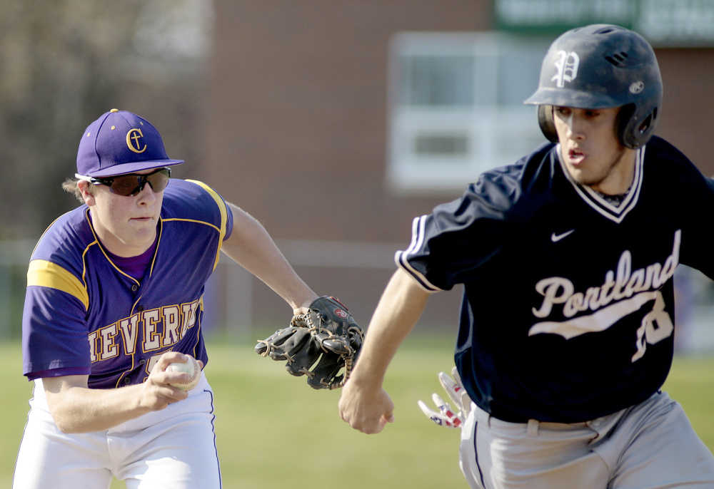 Jonathan Bernier of Cheverus runs down Charles Barnard of Portland, who was caught in a rundown during the fourth inning. Barnard pitched a complete game and also went 3 for 3, driving in three runs.