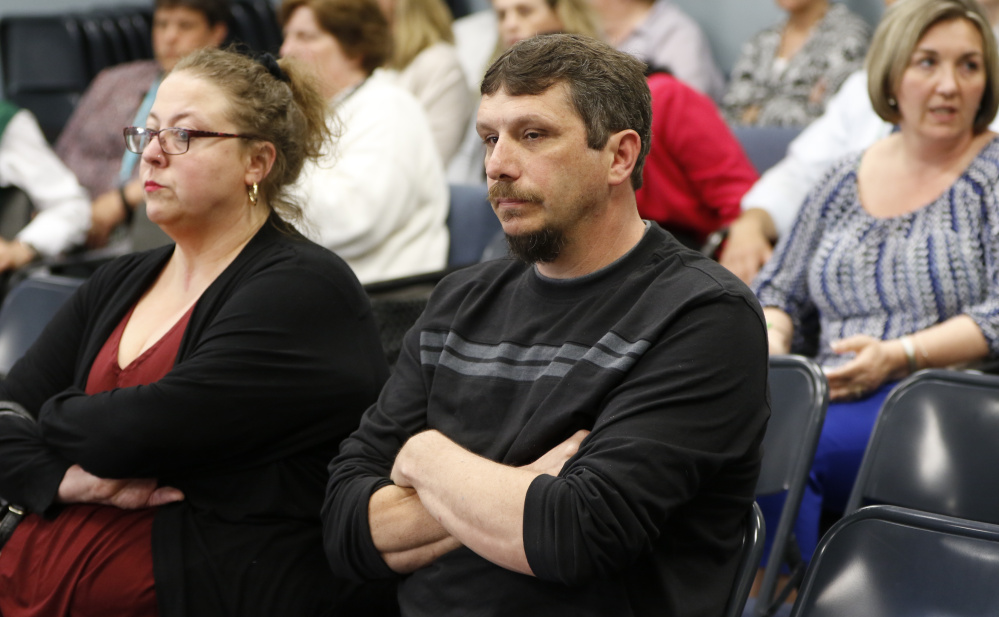 Richard Bourgeois-Lang, center, and his wife, Melissa Bourgeois-Lang, wait to hear from the SAD 6 school board Tuesday. Board rules have kept them from weighing in on Superintendent Frank Sherburne's hiring of his son in violation of the district's nepotism policy.