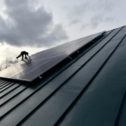 "Jake Hunt, an employee with InSource Renewables in Pittsfield, installs solar panels in East Vassalboro. Vaughan Woodruff, the company's owner and an advocate of the proposed solar legislation, says an amendment late in the process served as a distraction and ""gave shelter to opponents."" The bill ultimately failed to override Gov. Paul LePage's veto by two votes."