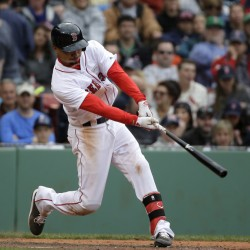 Boston's Mookie Betts hits a tiebreaking RBI triple in the seventh inning Sunday against Houston at Fenway Park.