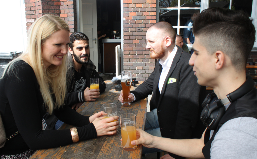 From left, Cindy Spieker, Ahmed Haj Ali, Paul Spieker and Abdul Wahab get acquainted in Berlin. The group met through a website called