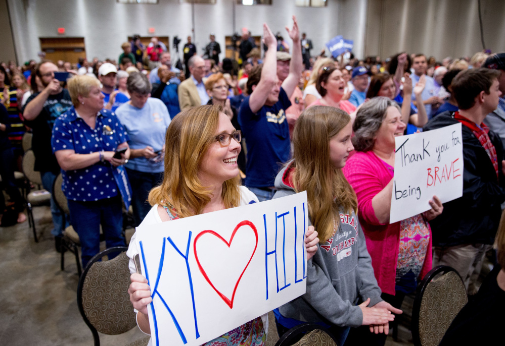 Supporters stand as Democratic presidential candidate Hillary Clinton arrives to speak at an event in Kentucky on Monday.