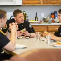 Firefighter Troy Greenip, Capt. Chris Goodall and firefighter (and cook) Ryan Thomson share a healthy lunch at Portland's Rosemont Station.