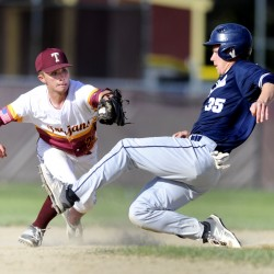 Luke Chessie of Thornton Academy puts the tag on Zach Fortin of Portland, who was attempting to steal second base, to get the second out in the sixth inning with the game tied 2-2.
