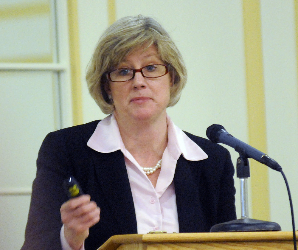 Patricia Quinn of the The Northern New England Passenger Rail Authority speaks on Tuesday at the rail summit in Augusta.