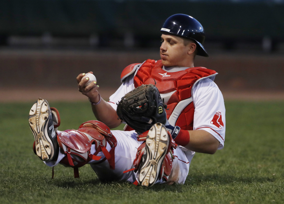 Portland catcher Jake Romanski catches a foul ball in the ninth inning Tuesday. Joel Page/Staff Photographer