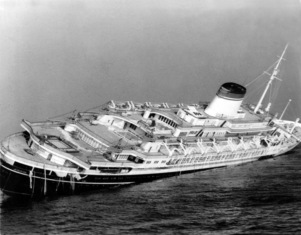 The Italian luxury liner Andrea Doria keels far over to starboard before sinking 225 feet to the bottom of the Atlantic 45 miles off Nantucket Island, Mass.