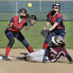 Moira Train of Greely slides safely into second base Wednesday as Gray-New Gloucester shortstop Alexa Thayer awaits a throw in front of second baseman Hannah Dixon.