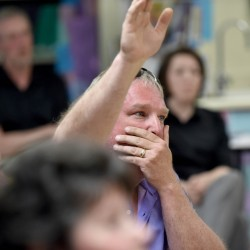 Seth Sweetser raises his hand during a meeting with the Freedom from Religion Foundation at Margaret Chase Smith Elementary School in Skowhegan on Wednesday.