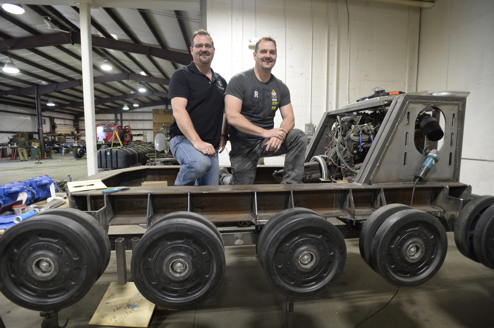 Geoffrey and Michael Howe are building the track base for a human-piloted battle robot at their Waterboro company, Howe & Howe Technologies Inc. In charge of providing the robot with speed and mobility, the Howes' tank-like base will be powered by a V8 engine.