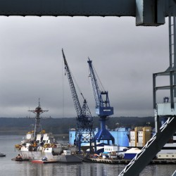 One union at Bath Iron Works has filed a complaint in federal court alleging that an arbitrator sided with the shipyard in a recent contract dispute in order to secure future arbitration work. The company says the decision was proper.