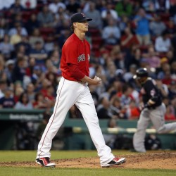 Boston's Clay Buchholz walks back to the mound after giving up a three-run home run to Cleveland's Jason Kipnis in the third inning of the Red Sox' 4-2 loss to Friday in Boston.