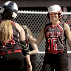 Sara Ring of Wells, left, is welcomed by teammate Casi Haye after scoring Friday during a 14-0 victory at Freeport – a game that ended after five innings. Wells improved its record to 8-5 and Freeport dropped to 3-10.