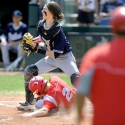 Ben Conti of South Portland slides into home as Camren King of Portland waits for the throw in the first inning of Saturday's game at Hadlock Field in Portland. Portland won 5-4 in eight innings.
