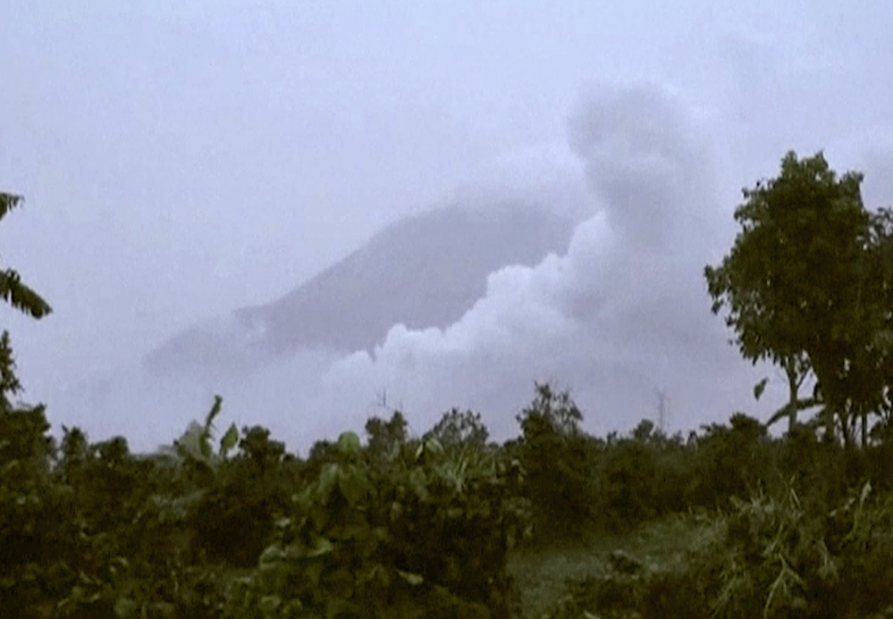 Clouds of ash rise from Mount Sinabung in North Sumatra, Indonesia, on Saturday.