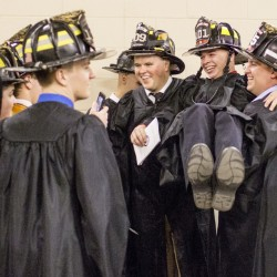 PORTLAND, ME - MAY 22: Jake Pantano of North Attleboro, Mass., center, is hoisted by fellow fire science graduates before they march Southern Maine Community College's 69th annual graduation ceremony at the Cross Insurance Arena in Portland Sunday, May 22, 2016. The school graduated nearly 1,100 students. (Photo by Gabe Souza/Staff Photographer)