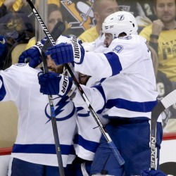 Tampa Bay's Tyler Johnson, right, celebrates with Jason Garrison, left, and Nikita Kucherov after Johnson was credited with the goal that beat the Penguins, 4-3.