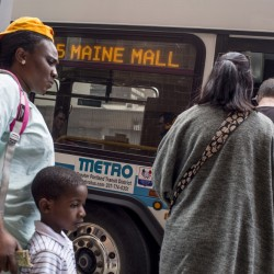 Riders board a Metro bus at the Elm Street station. Metro is expanding service to Freeport and, along with South Portland's bus service and Casco Bay Lines, launching an app to help riders track pickup times on their smartphones, above.