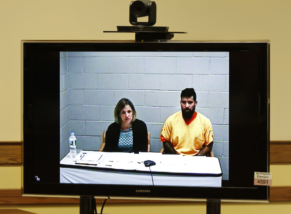 Robert Ferrera III, with court-appointed attorney Lisa Chmelecki, appears in Springvale District Court via video link from the York County Jail on Monday.