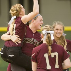 Maizie Lee, center, celebrates with Kaylee Burns, left, Libby Pomerleau, right, and Lindsay Luopa after Thornton Academy's 2-1 softball win Monday over Windham.