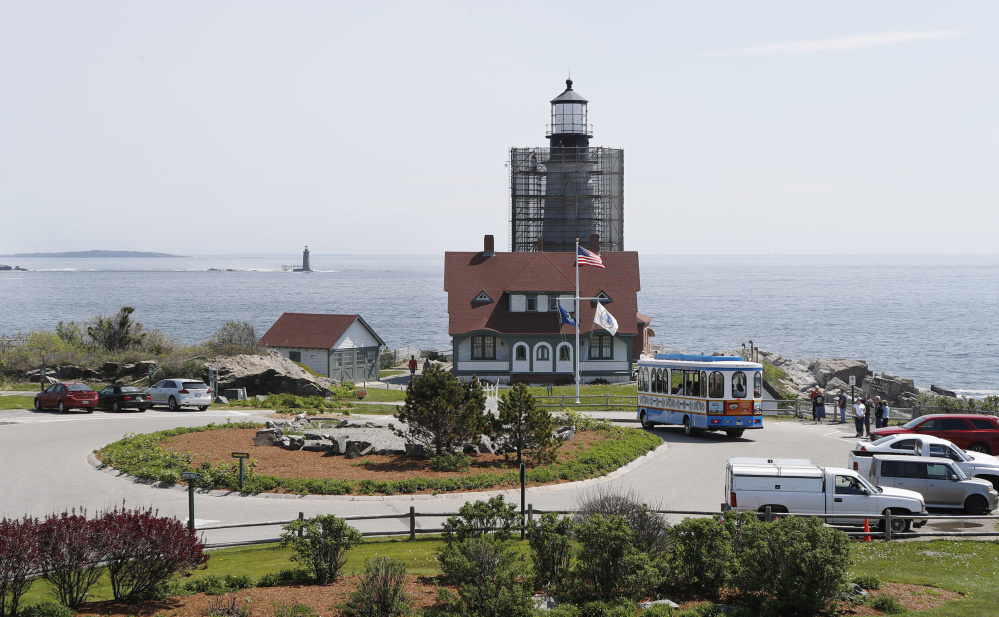 A trolley arrives at scenic Portland Head Light. Work on the lighthouse and buildings is expected to take until late June.