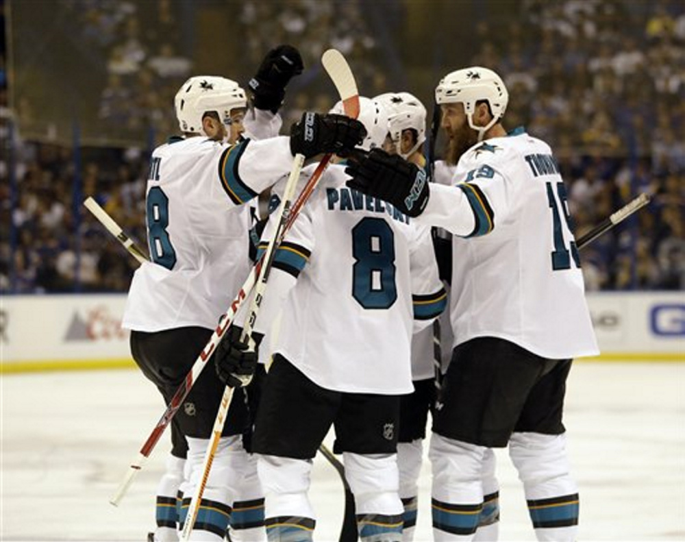 Sharks center Tomas Hertl, left, celebrates after scoring a first-period goal in Game 5 of the Western Conference against the Blues at St. Louis.