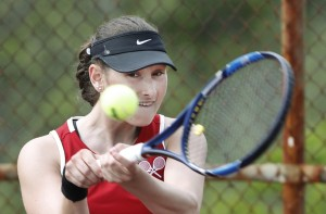 Scarborough's Megan Nathanson returns a shot during her 6-0, 6-0 win in the No. 1 singles match Monday against Gorham. Scarborough won a clash of unbeaten teams, 4-1, to end the regular season with a 12-0 record.