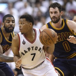Toronto's Kyle Lowry controls the ball as Cavaliers forward Kevin Love, 0, and guard Kyrie Irving defend during the second half of Monday's Game 4 of the Eastern Conference finals at Toronto.