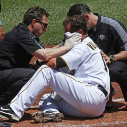 Pittsburgh pitcher Ryan Vogelsong is attended to by team trainers after being hit in the head by a pitch from Colorado's Jordan Lyles in the second inning at Pittsburgh on Monday. Voglesong was later admitted to a hospital with injuries to his left eye.
