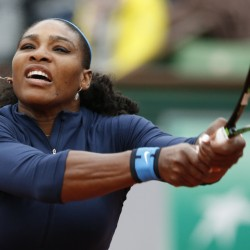 Serena Williams returns a shot Tuesday during her first-round match against Magdalena Rybarikova at the French Open. Williams rolled to a 6-2, 6-0 victory.