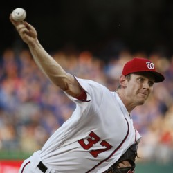 Stephen Strasburg of the Nationals throws a pitch in Tuesday night's game against the visiting Mets. Strasburg improved to 8-0 by striking out 11 in the Nationals' 7-4 win.