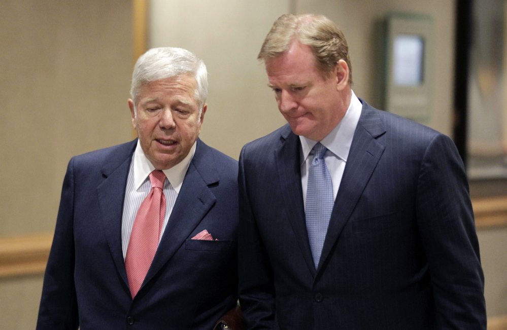 Robert Kraft, owner of the New England Patriots, left, talks with NFL Commissioner Roger Goodell while arriving at the NFL football owners meetings in Indianapolis, Tuesday, May 24, 2011. On Wednesday, Kraft and the Patriots joined Tom Brady in supporting the appeal of Brady's four-game suspension. (The Associated Press)