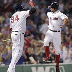 Boston's Xander Bogaerts, right, leaps as he celebrates his solo home run with David Ortiz off Colorado Rockies starting pitcher Chad Bettis in the fourth inning Wednesday night in Boston.