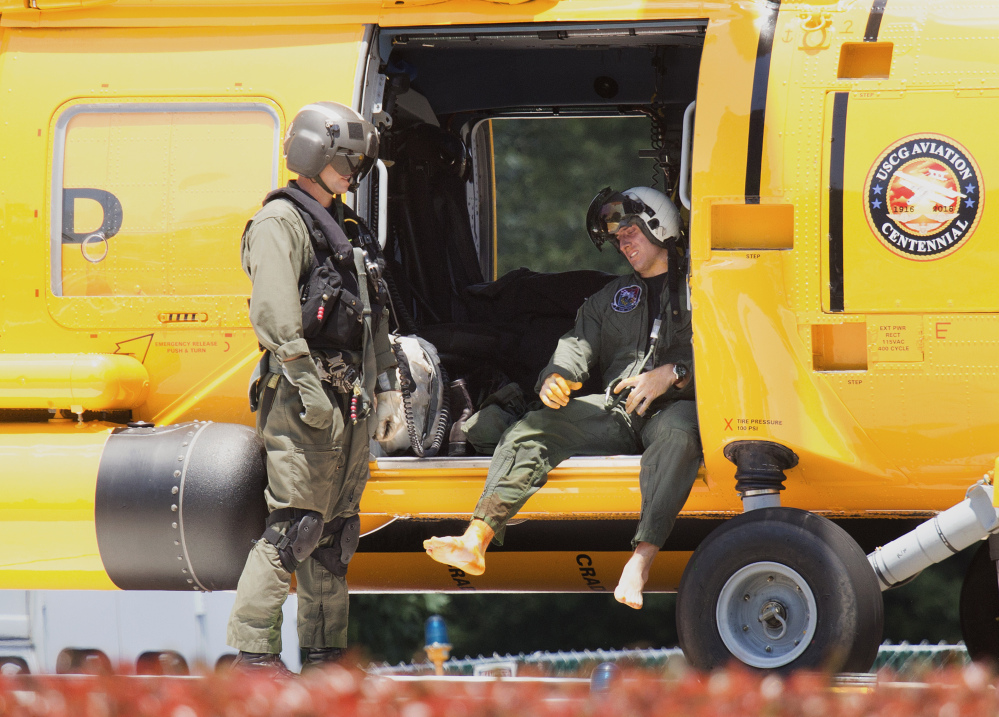 A Navy aviator involved in a crash waits to exit a U.S. Coast Guard helicopter at Sentara Norfolk General Hospital in Norfolk, Va., on Thursday. Two Navy jet fighters collided off the coast of North Carolina during a routine training mission on Thursday.