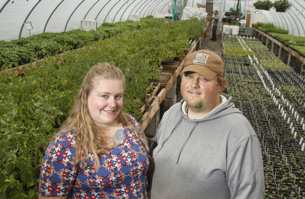Jonathan Tibbetts with his wife, Kelly, at Tibbetts Farm in Lyman.