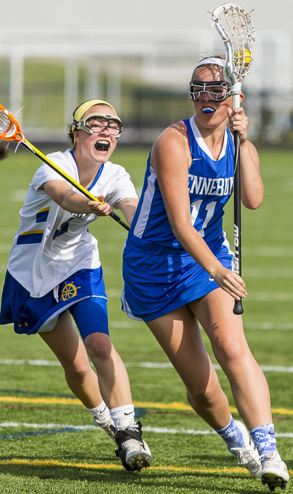 Kristen Koch of Kennebunk rolls around London Bernier of Falmouth during their girls' lacrosse game at Falmouth. Ben McCanna/Staff Photographer