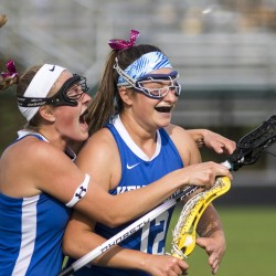 Kyra Schwartzman of Kennebunk, right, celebrates with teammate Olivia Sandford after scoring the overtime goal Thursday in a 7-6 victory against Falmouth. Sandford assisted on the play.