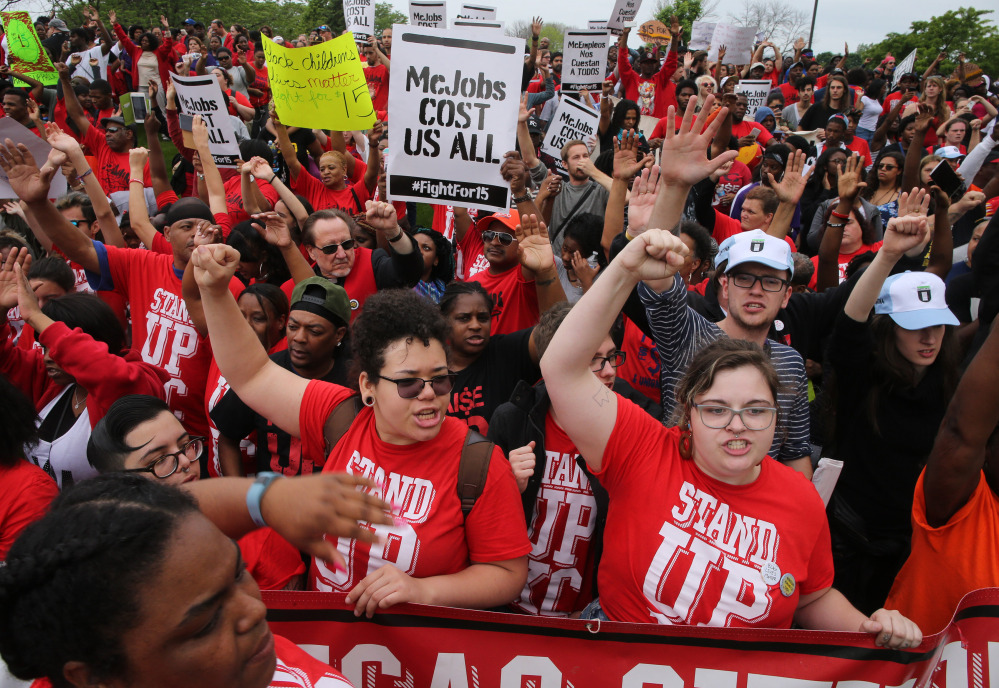 Protesters converge at the McDonald's campus along Jorie Boulevard in Oak Brook, Ill., on Thursday to rally for $15-per-hour wages during the annual shareholders meeting.