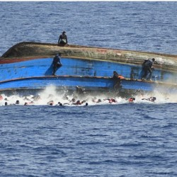 In this picture series starting at upper right, migrants try to jump in the water before their boat overturns Wednesday off the Libyan coast. The Italian navy later recovered a few bodies.