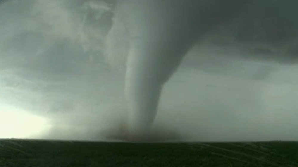 Image made from a video by KWTV-KOTV shows a funnel cloud moving across a field near Dodge City in Ford County, Kan., on Tuesday. Tornadoes destroyed several homes in western Kansas as a series of severe storms swept across the Plains.