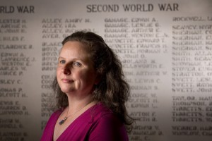 Posing near the Veterans Wall in the Southport Memorial Library, Sarah Sherman McGrail says she has collected 228 stories from Korean and Vietnam war veterans from the Boothbay region.