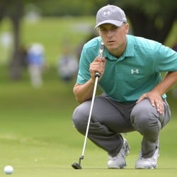 Jordan Spieth lines up a shot on the first green during the Dean & Deluca Invitational golf tournament at Fort Worth, Texas on Thursday. Spieth is three shots off the lead.