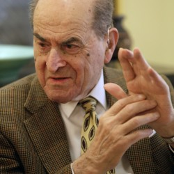 FILE - In this Feb. 5, 2014 file photo, Dr. Henry Heimlich describes the maneuver he developed to help clear obstructions from the windpipes of choking victims, while being interviewed at his home in Cincinnati.  Heimlich  recently used the emergency technique for the first time himself to save a woman choking on food at his senior living center. Heimlich said Thursday, May 26, 2016 that he has demonstrated the well-known maneuver many times through the years but had never before used it on a person who was choking. (AP Photo/Al Behrman)