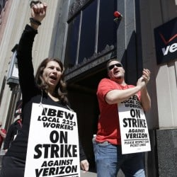 Verizon workers picket outside one of the company's facilities in Boston in April. Striking Verizon employees may be back to work next week after the company and its unions reached an agreement in principle Friday for a four-year contract.
