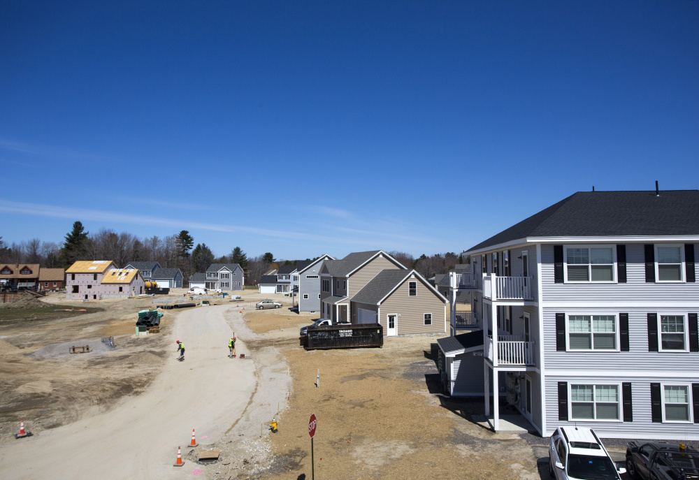 Construction is underway on new homes in a Westbrook development. The April report from the Maine Association of Realtors said home sales had spiked nearly 25 percent over April 2015 sales. Unfortunately, prices rose only slightly – 1.1 percent – to a statewide median of $180,000. Derek Davis/Staff Photographer
