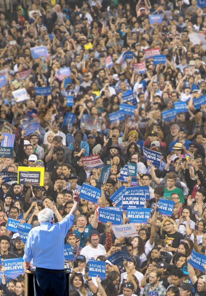 Democratic presidential candidate Sen. Bernie Sanders, I-Vt., waves to supporters at a rally on Sunday, May 22, 2016, in Vista, Calif.  The Associated Press