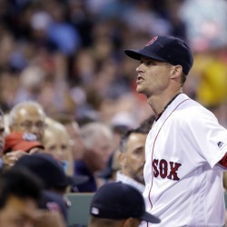 Boston Red Sox pitcher Clay Buchholz reacts to fans as he walks into the Boston dugout after the fifth inning of Thursday's game at Fenway Park. (AP Photo/Elise Amendola)