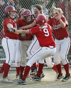 Kaleigh Scoville, wearing No. 9, celebrates with her Scarborough teammates after her RBI single in the bottom of the seventh inning Friday gave the Red Storm a 4-3 win over Biddeford.