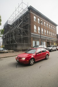 Workers are now repairing moisture damage on the building. John Ewing/Staff Photographer