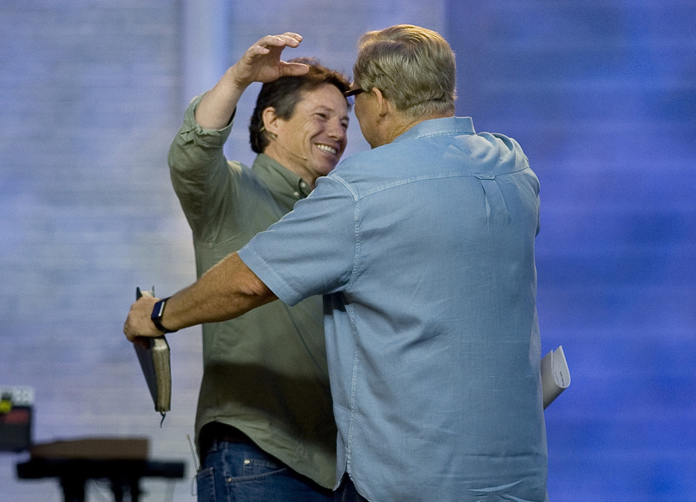 Danny Duchene is greeted by Rick Warren in April during a Sunday service. After 32 years in prison, Duchene was freed, partly in response to a letter from Warren asking the parole board to allow him to hire Duchene as a pastor in his Saddleback Church's prison ministry.